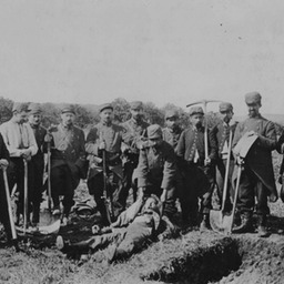 French soldiers burying German dead